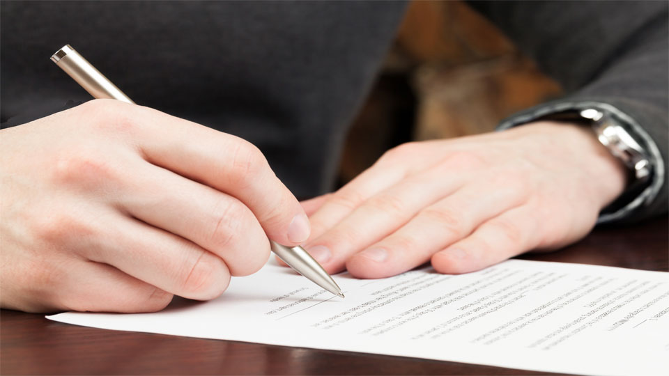 Man preparing to sign a document