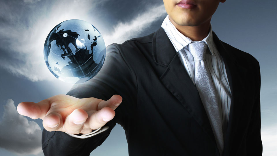 A businessman levitating a globe over his hand