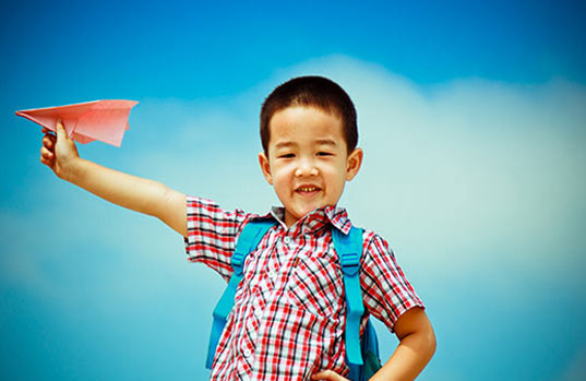 Cute Thai Boy With Paper Airplane