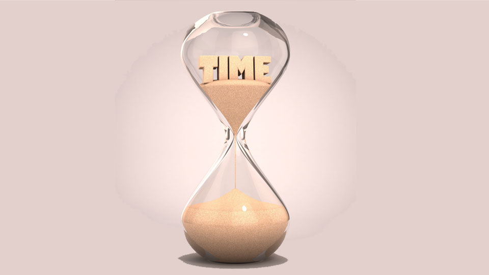 """Hourglass Running with """"Time"""" Written In Sand"""